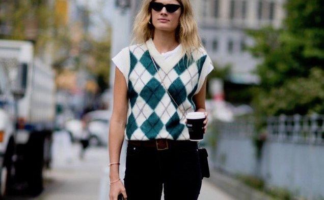 new york street style white t shirt argyle sweater vest black jeans landscape cropped